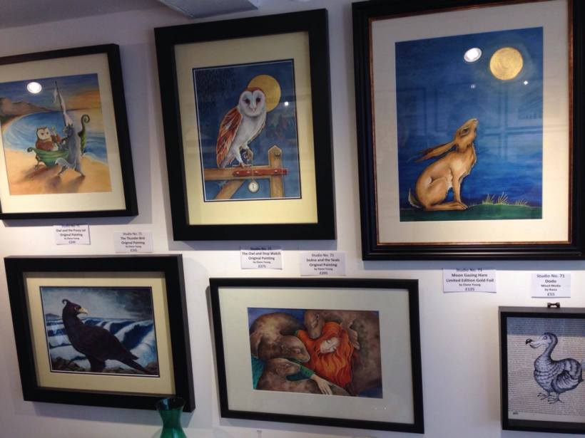 Studio 71 Totnes gallery with Diane Youngs paintings: Owl, Pussy Cat, Hare, Thunderbird, and Sedna with Seals