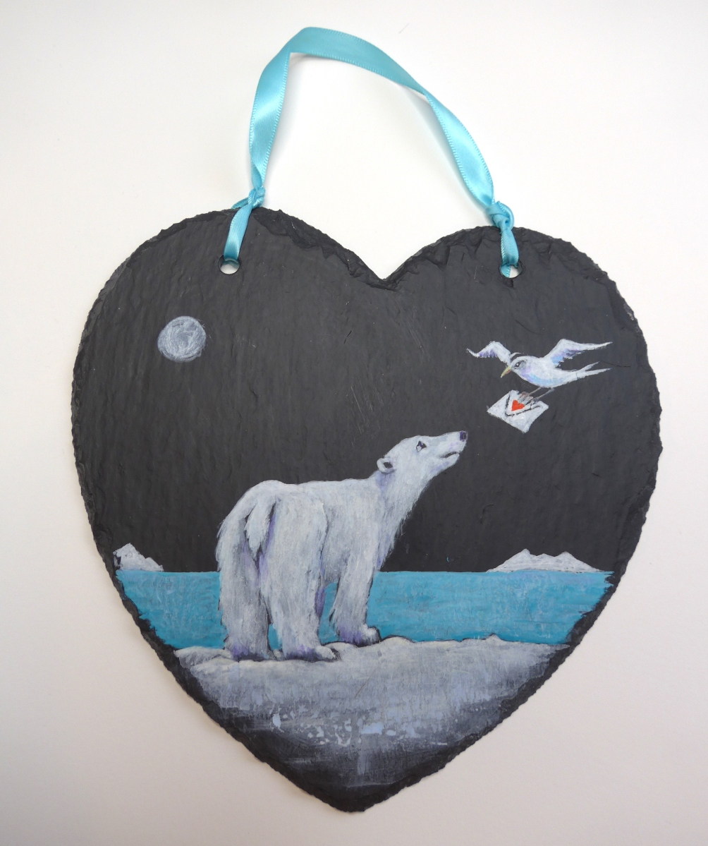 Painting of a polar bear and tern with a message letter on heart shaped slate