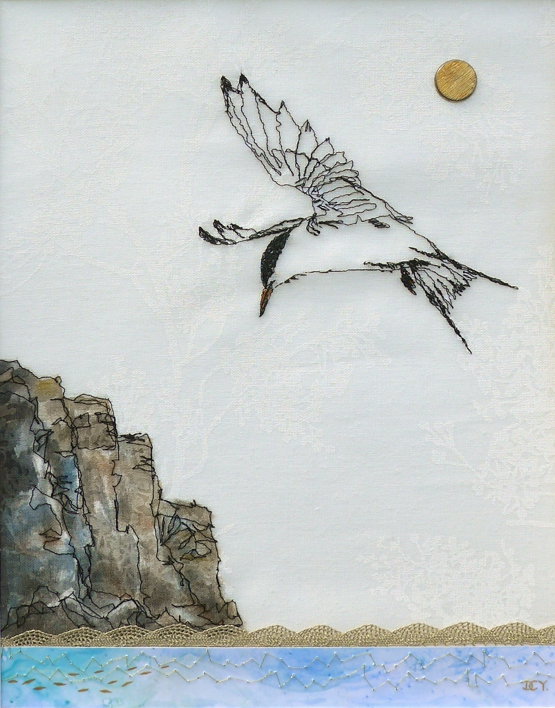 Machine sewn drawing of a tern fishing with collage by artist Diane Young