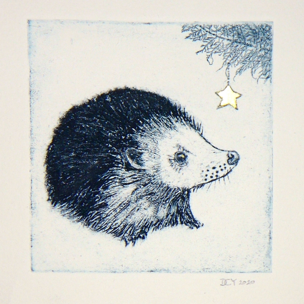 Collagraph of a hedgehog with a gold leaf star hanging from a monoprinted tree