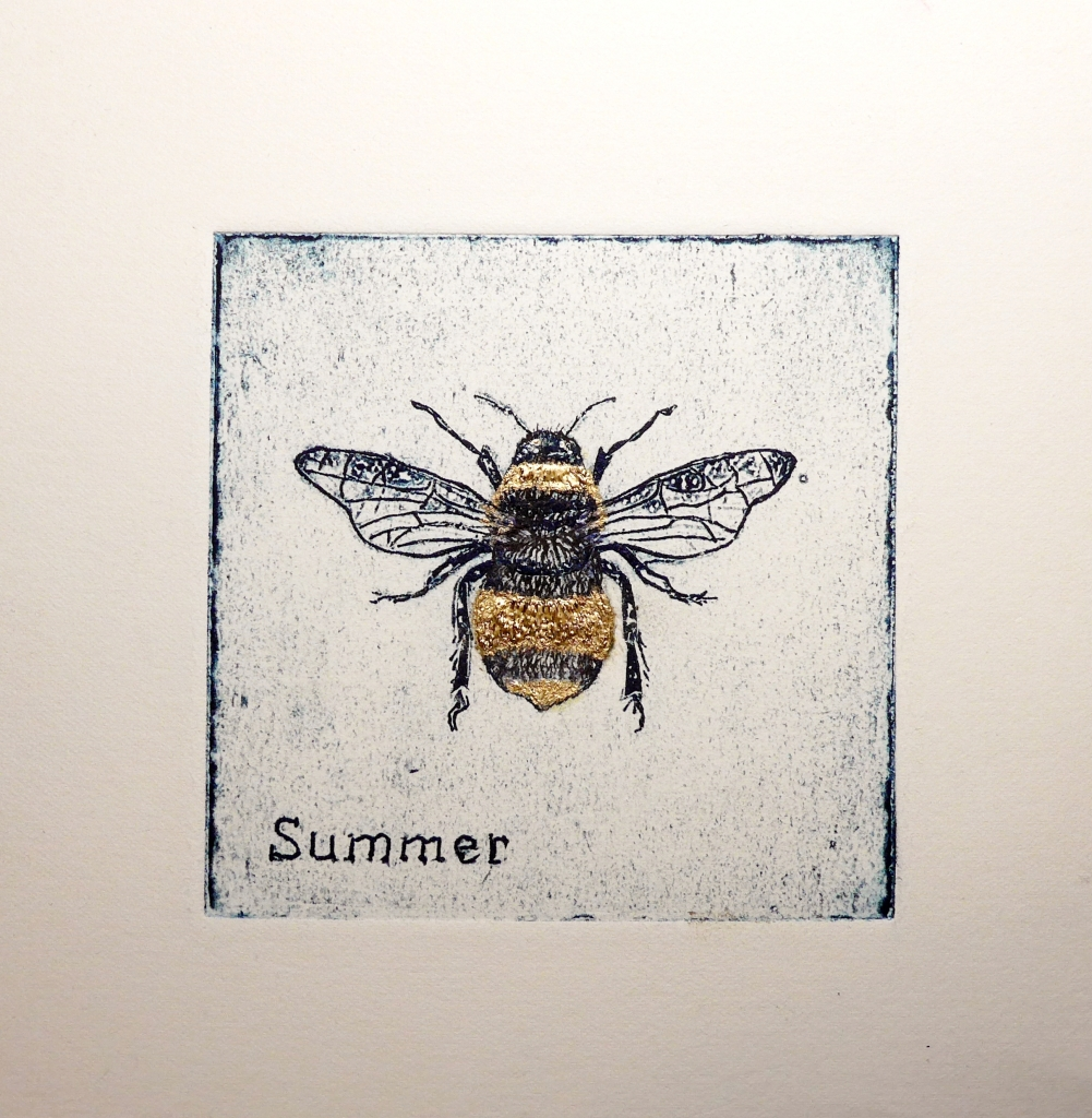 Collagraph print showing a bumble bee with gold ink detail on the stripes.